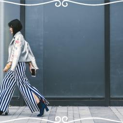 浮誇銀色皮衣、藍白條紋寬褲、麂皮深藍高跟鞋